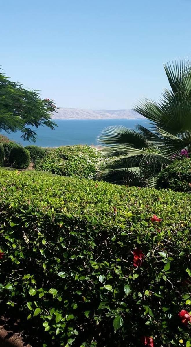 Mount of the Beatitudes with the Sea of Galilee in the background.