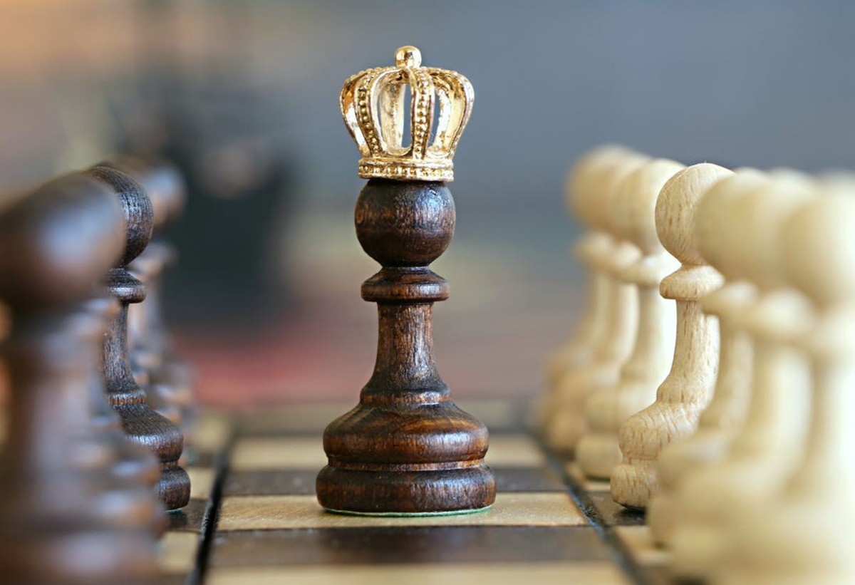 The pawn with a crown on his head. Pawns love promotion into queens and other pieces such as rook, knight, and bishop.