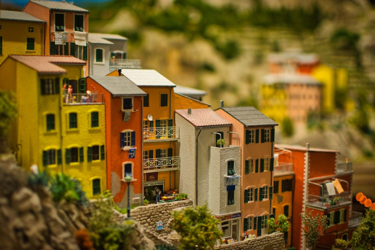 A miniature model view of Mediterranean houses.