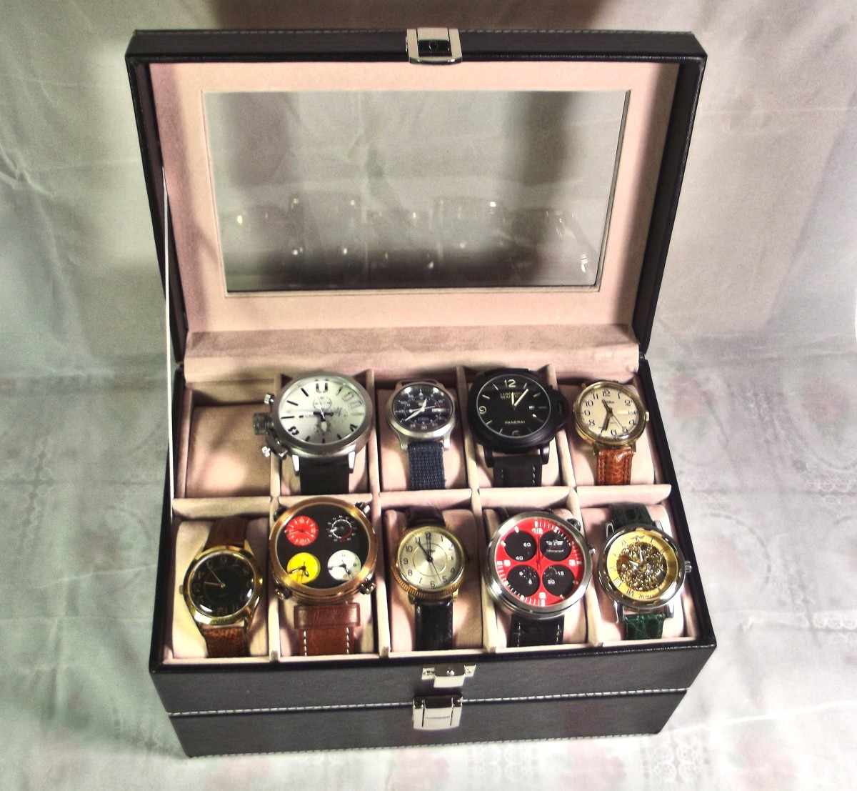Watch box is mainly composed of faux leather reinforced with medium density fiberboard.