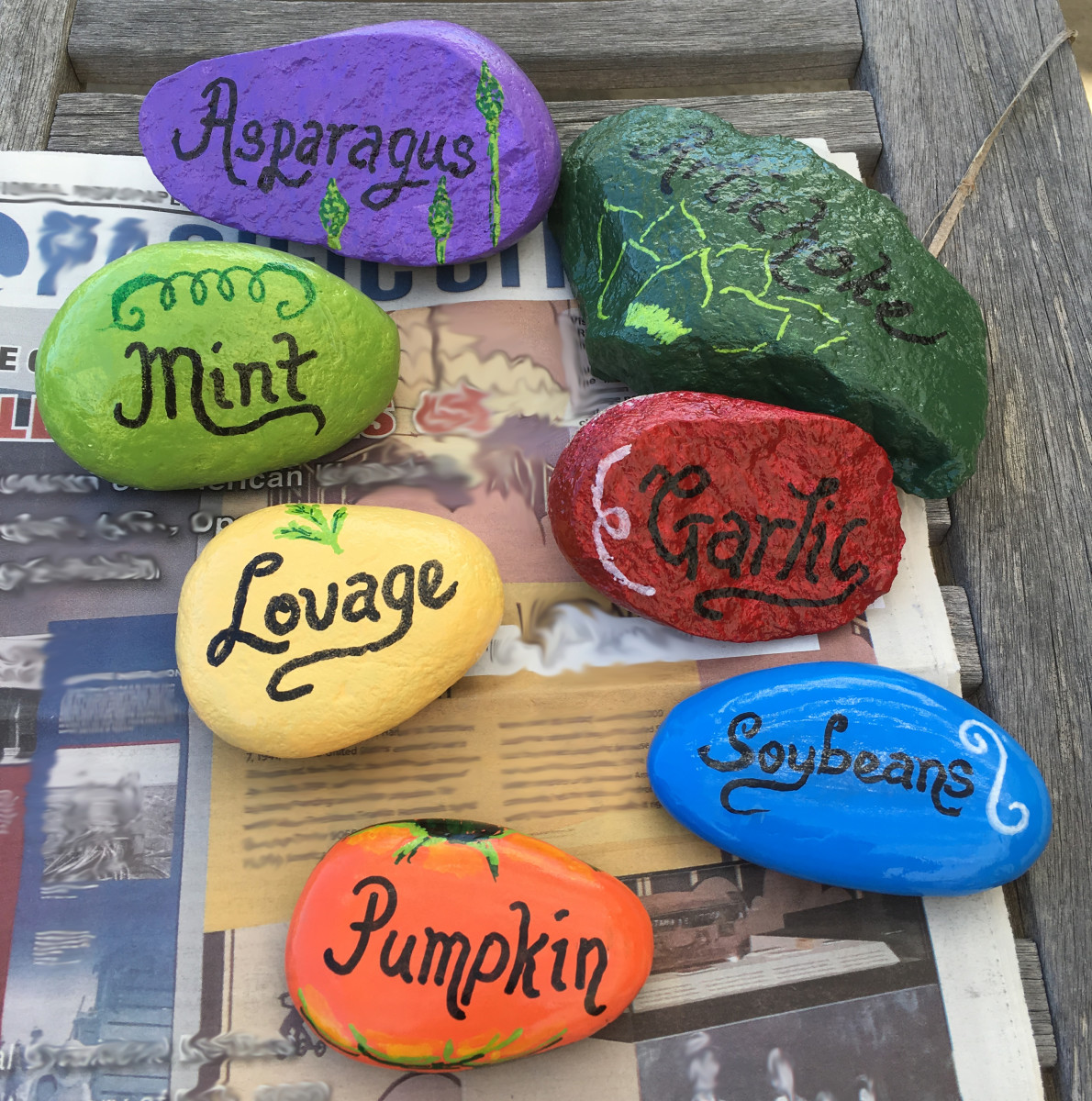 Painted stone garden markers for the vegetable garden.