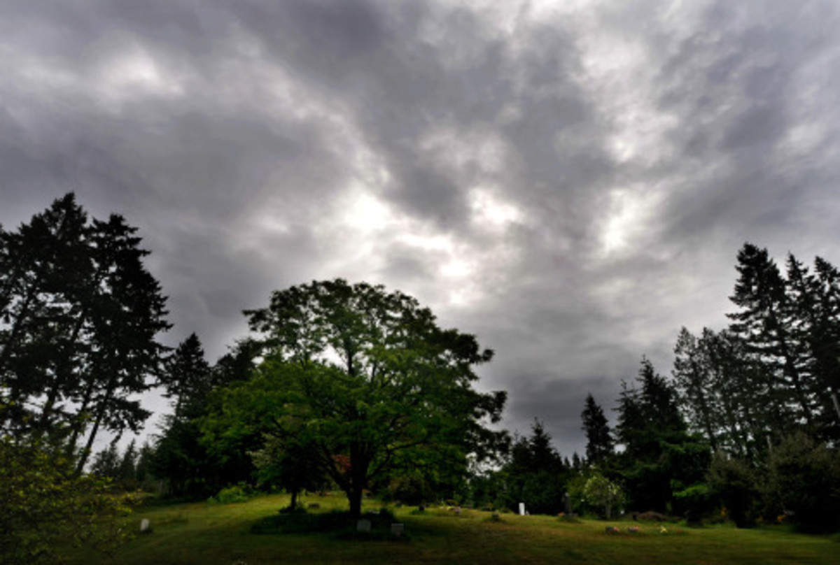 A storm front moved in during the cemetery service.