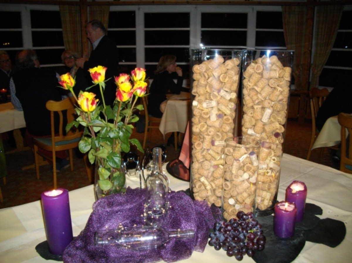 Centerpieces featuring roses,candles and creative wine corks!