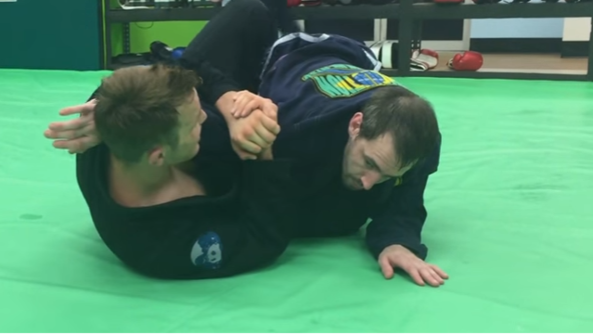 Using the reverse armbar.