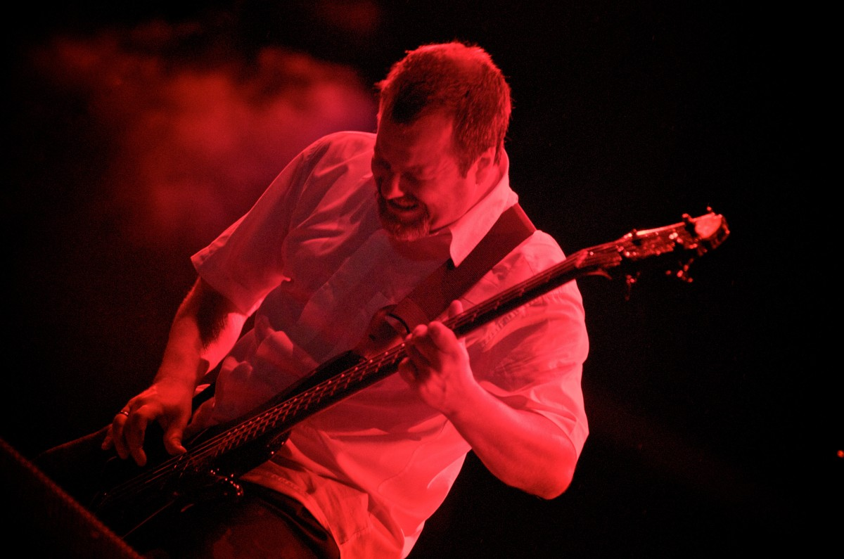 Billy Gould laying down the boom onstage with Faith No More in 2009.