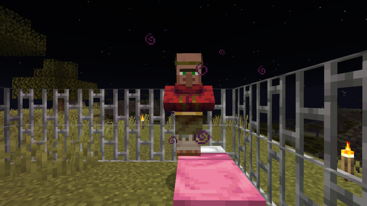 A cured villager waits out the night in the iron bar prison.