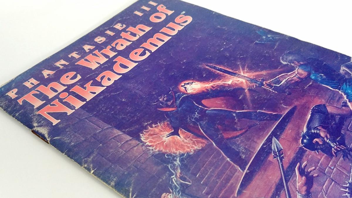 My badly battered game manual for Phantasie III: The Wrath of Nikademus.