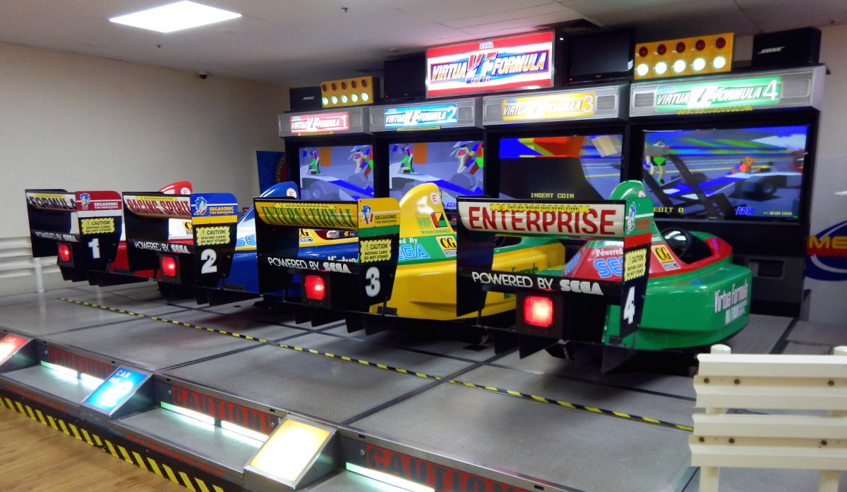 A row of Virtua Formula (1993) deluxe cabinets.