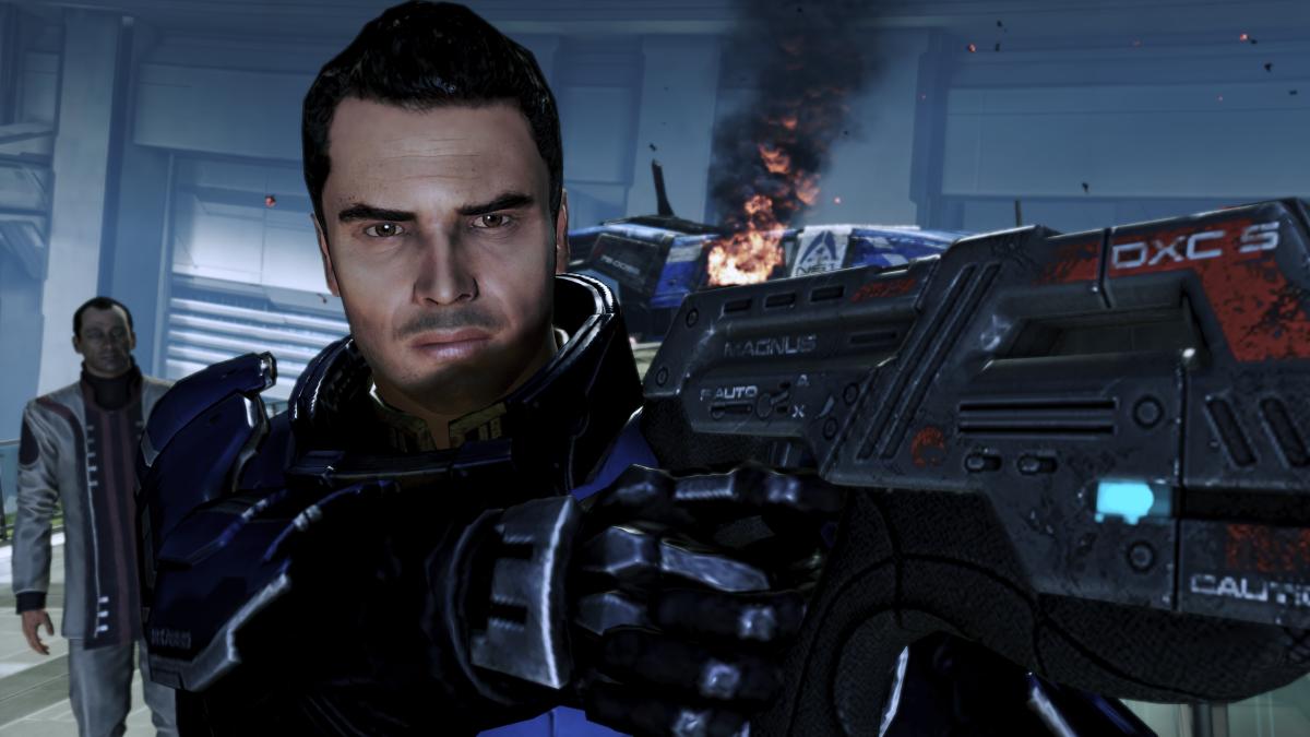 Confused Kaidan points a gun at Shepard.