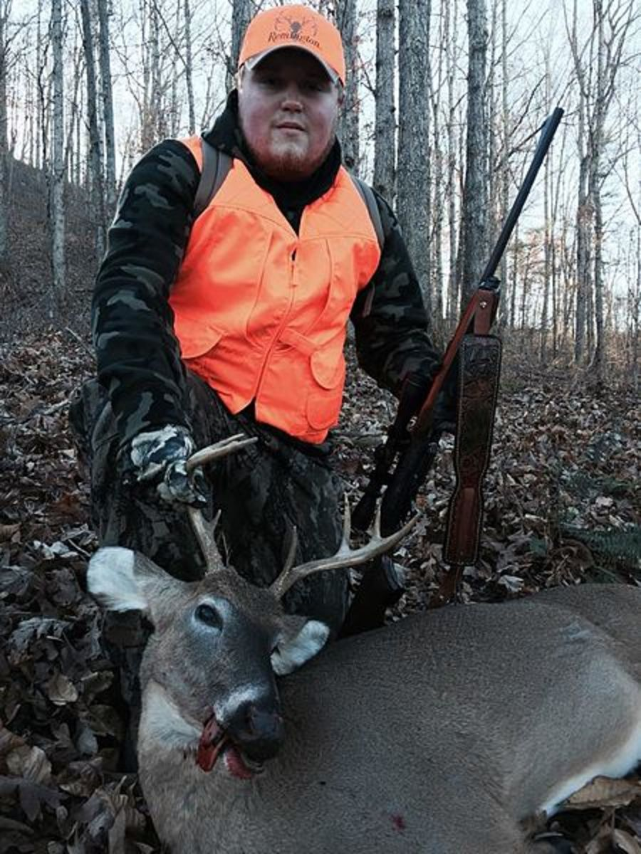 A deer hunter with his trophy buck.