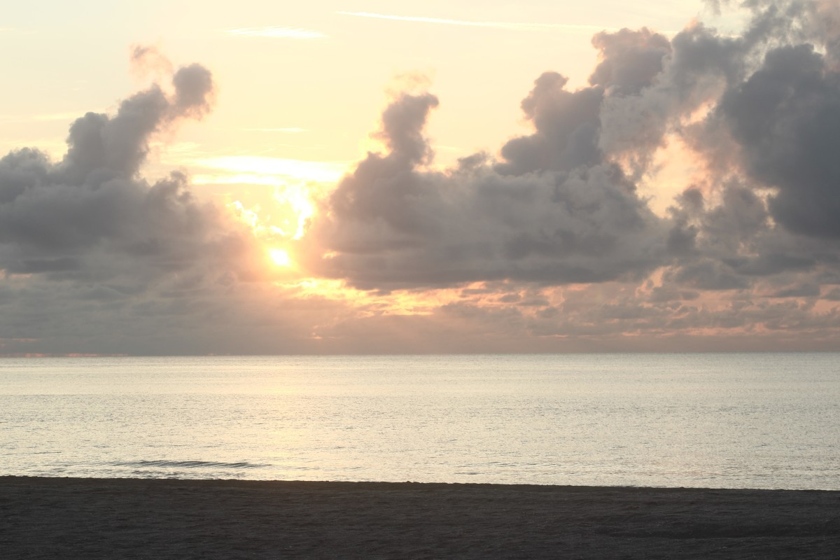 Learn how to capture beautiful scenes in nature, such as this sunrise over the Atlantic Ocean.