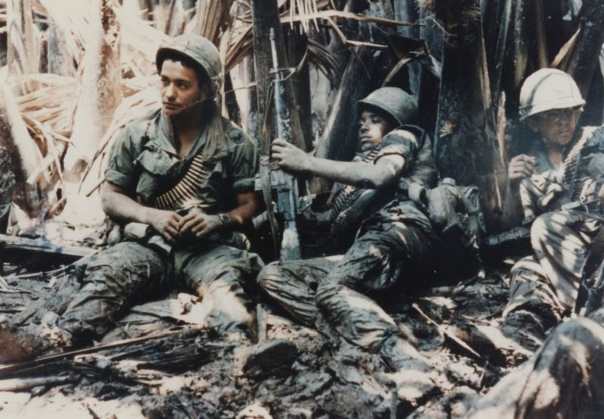 U.S. Army troops take a break during a patrol in Vietnam Conflict.
