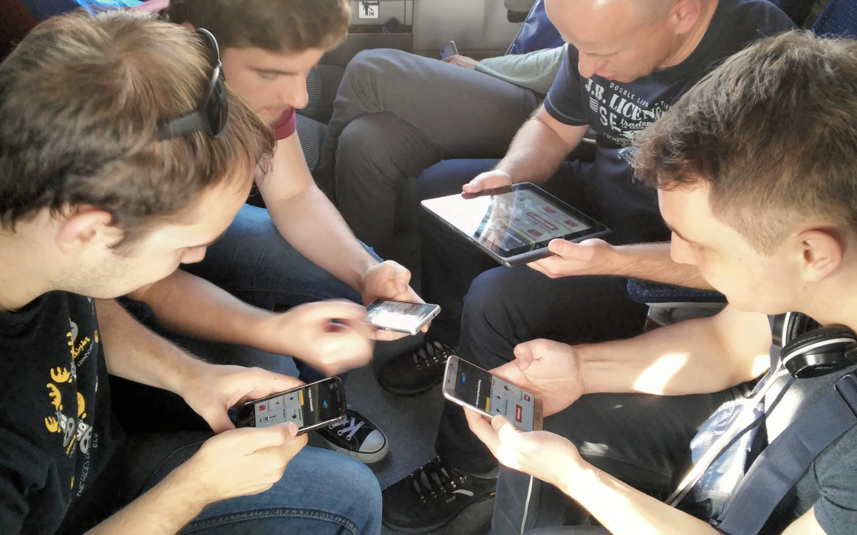 "Four people playing ""Spaceteam"" on their mobile devices connected by wifi/BT by Klapi, 2015"