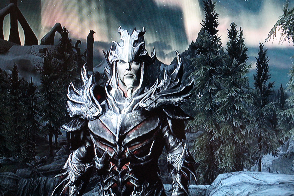 He's decked in a mix of Daedric and Dragon armors.