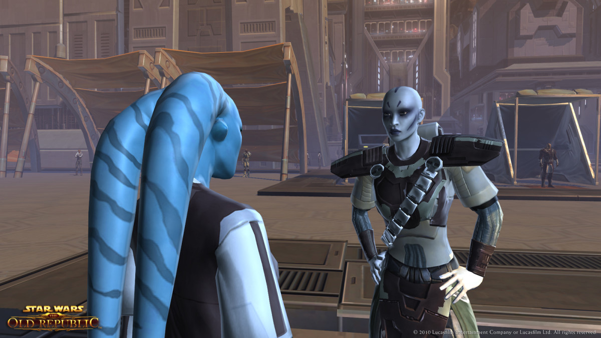 A Rattataki chatting with a Twi'lek