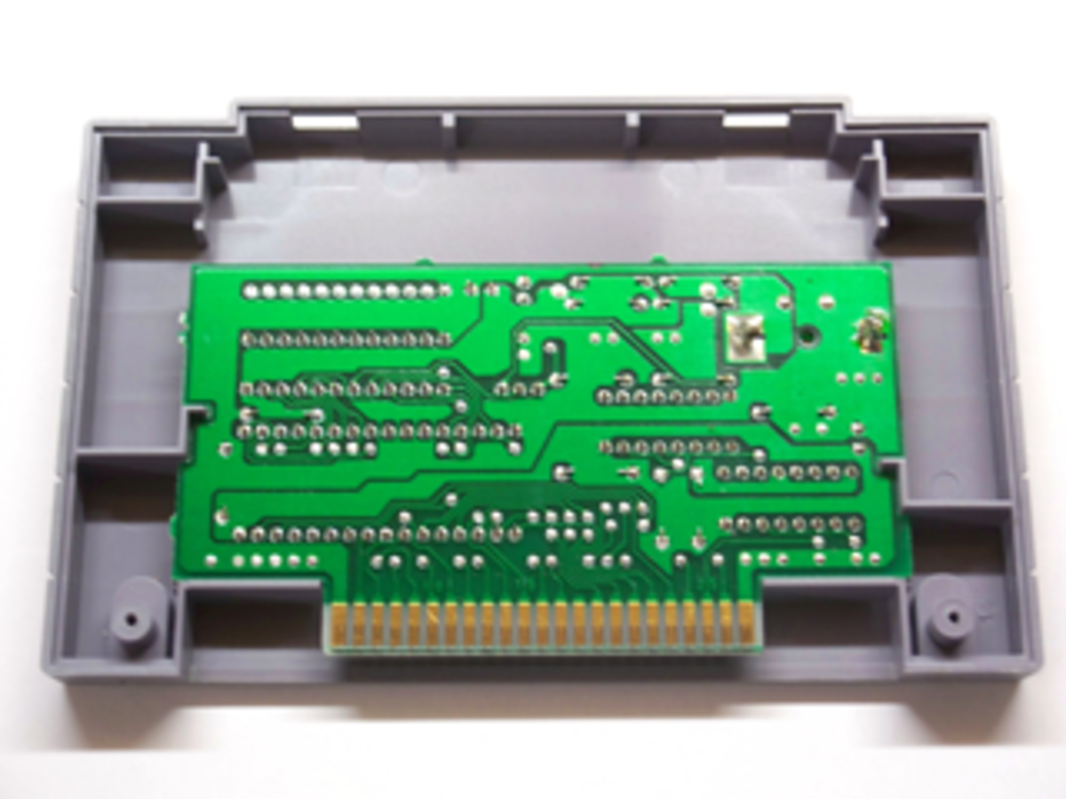 An un-cleaned SNES game motherboard with oxidized contacts.