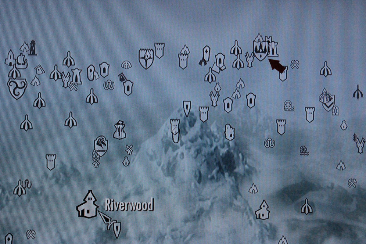 Follow the arrow to the College of Winterhold.