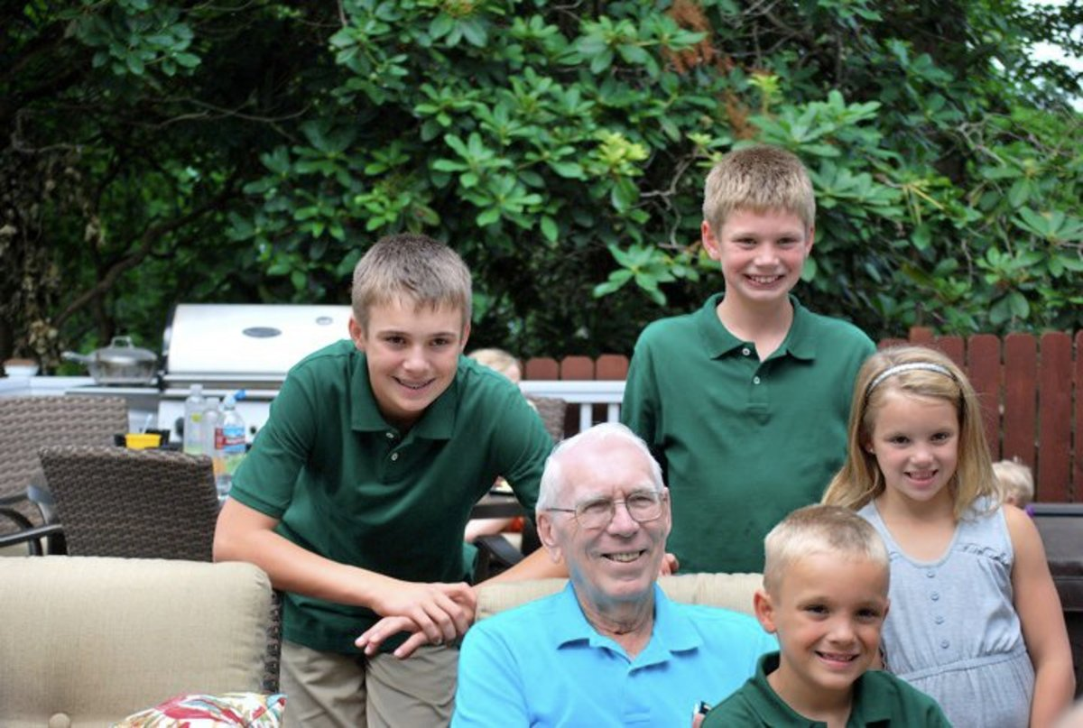 Grandpa is surrounded by loving great-grandchildren
