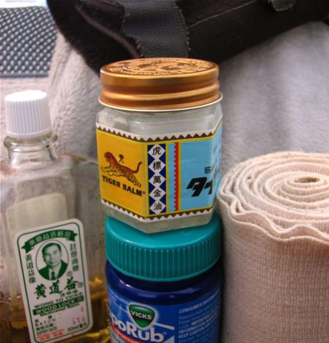 Menthol rubs, bandage, wrist brace and massage cushion.