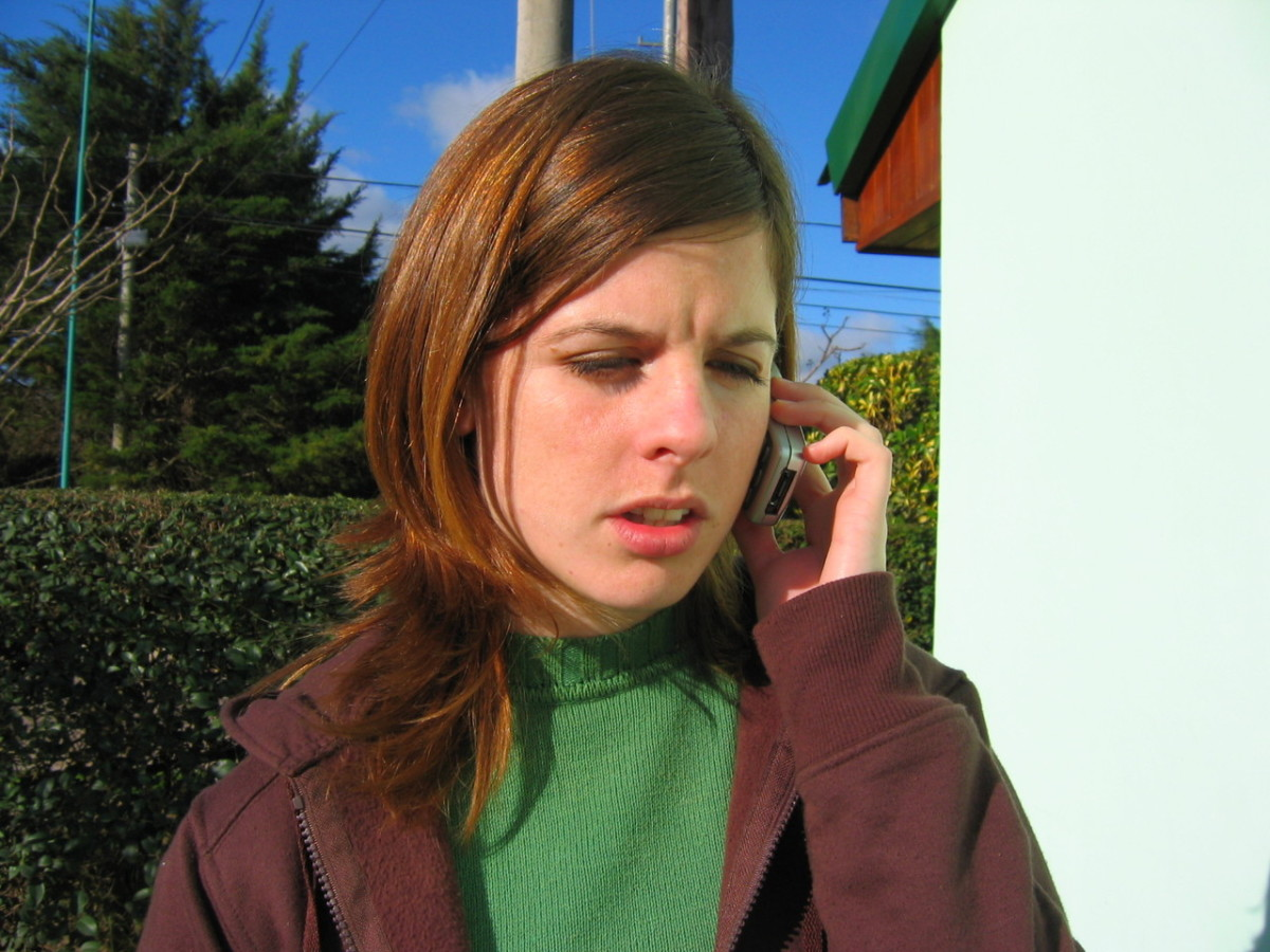 A woman who is not enjoying her time on the phone