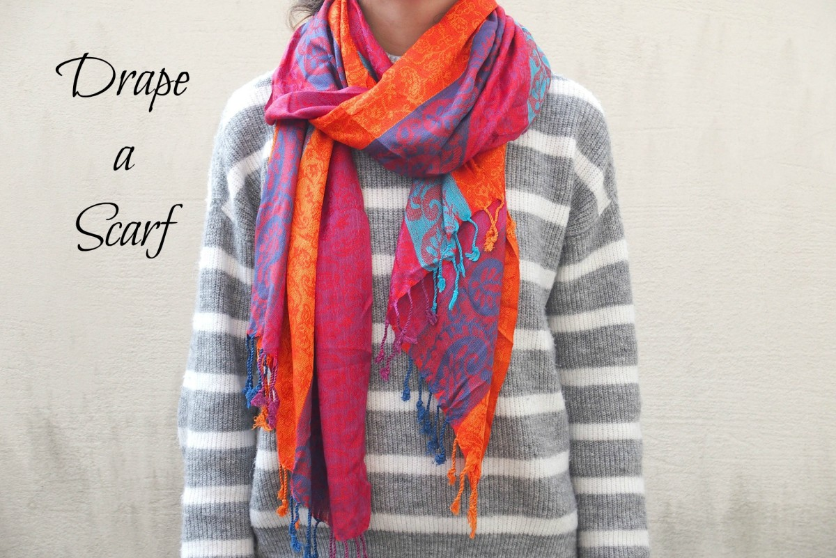 A scarf tied so that the ends drape across the chest is a very stylish look.