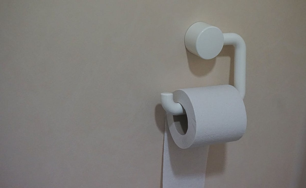 toilet paper roll hanging on a wall