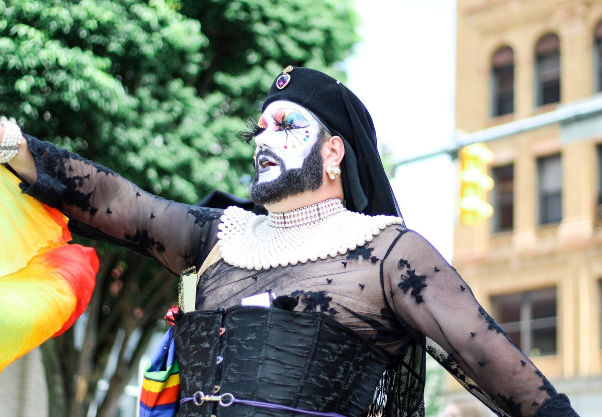 an individual celebrating at a Pride event