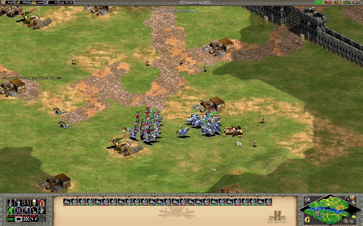 Engaging yellow units outside their walls in an attempt to siege them with trebuchet.