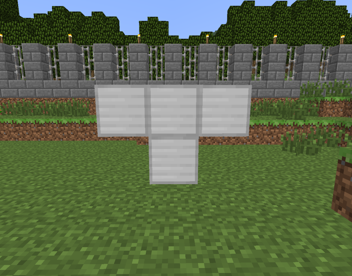 Placing a pumpkin on top of these four iron blocks creates one iron golem.