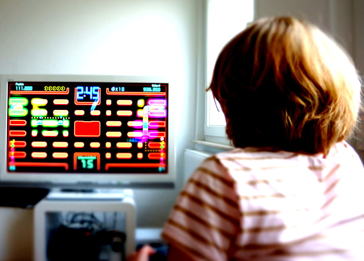 Someone addicted to video games ignores the world around them.