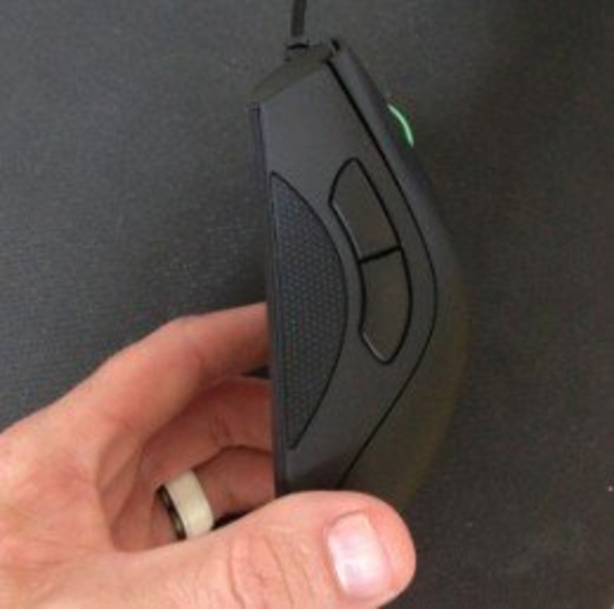 Here's a picture of me holding the Razer DeathAdder. As you can see the grips avoid that shiny slipper plastic that plagued versions prior to 2013.