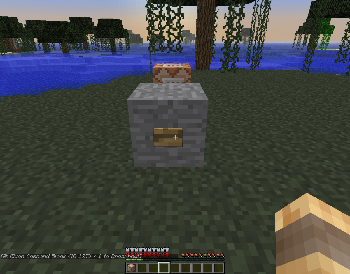 This command block gives the player who pushes the button a command block!