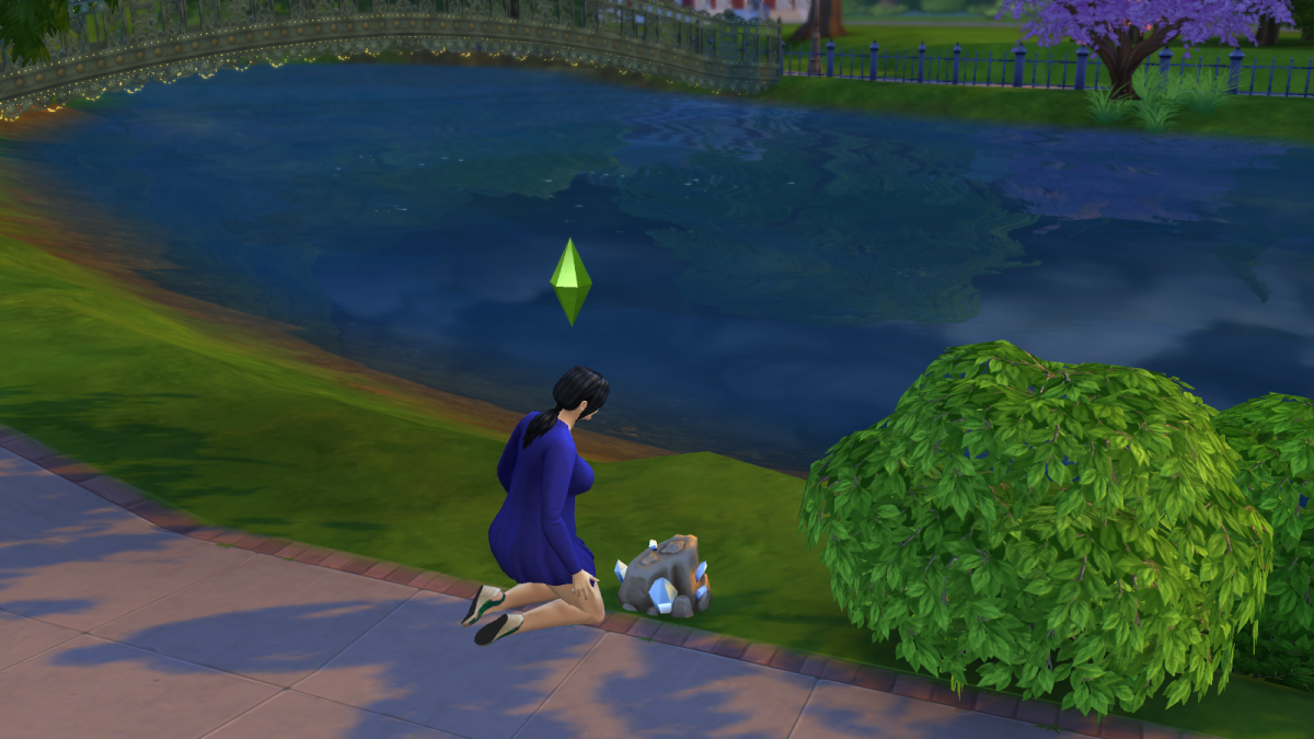 A sim inspecting a hunk of rock in The Sims 4. Rocks can be excavated to find items.