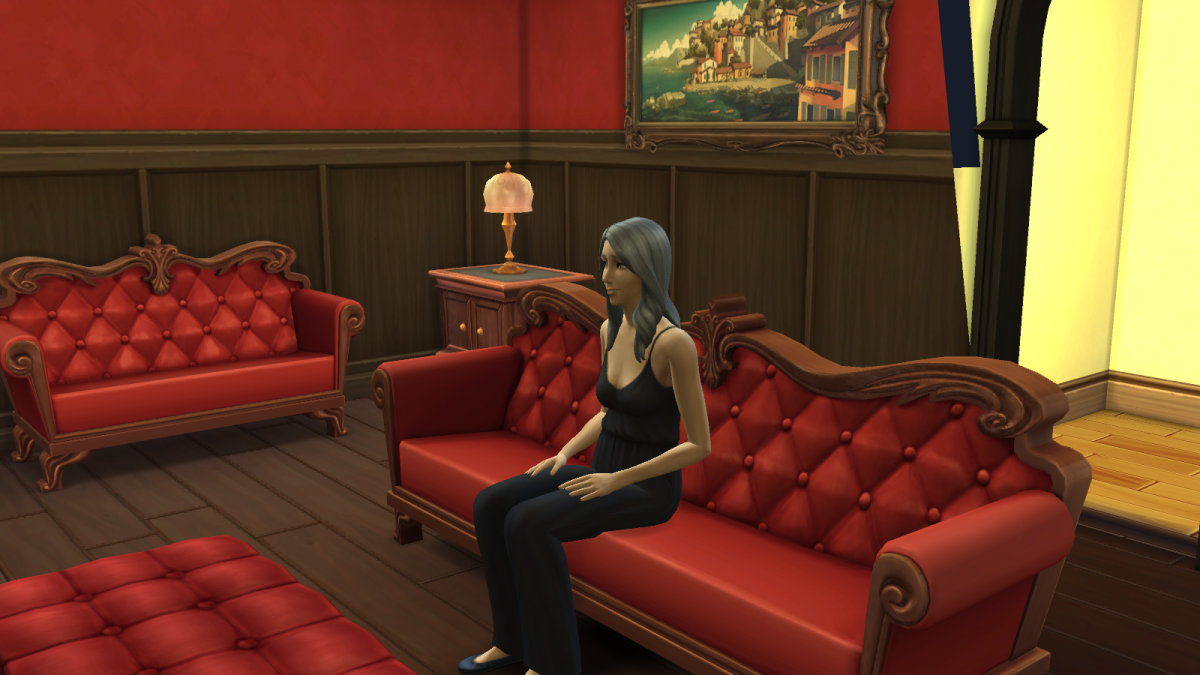 An elder sim in The Sims 4, watching TV. Old age is one way your sim can die, and it's often the most likely.
