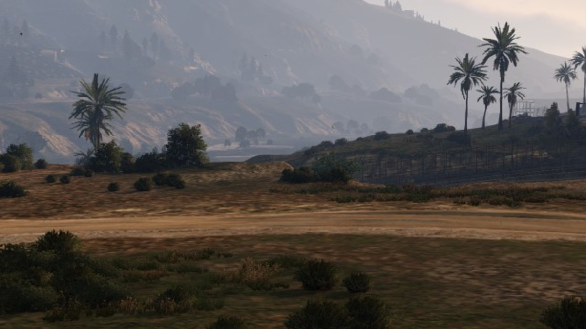"""You can use this landmass to enter the base easily, aim for between these two bushes to clear the fence. The next-gen version has more foliage making the """"land ramp"""" in the first screenshot harder to spot (as seen in the video walkthrough)."""