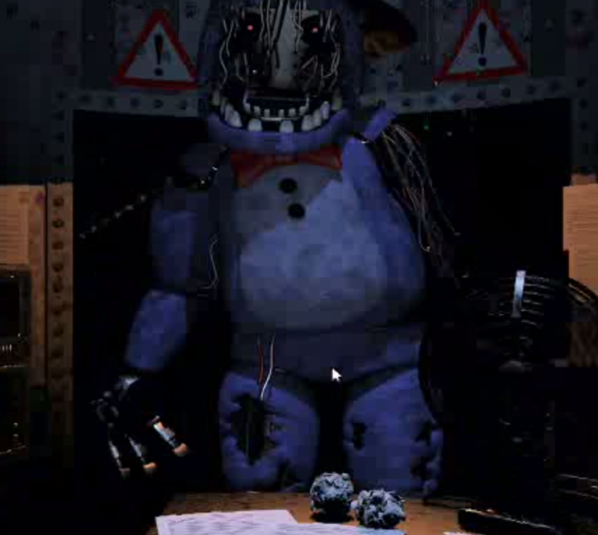Bonnie hulks over the desk. If you see this screen without putting on the Freddy Fazbear Head, you're probably dead already.