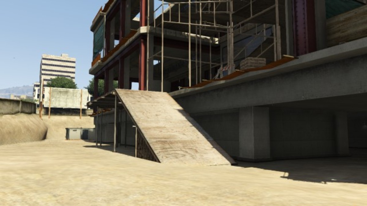 You'll see this ramp to the left of the parked Grangers. Use it to get up to the first floor.