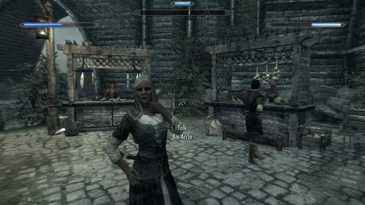 The NPC is now wearing a hood to keep out the rain, added by Wet and Cold an excellent Skyrim mod.