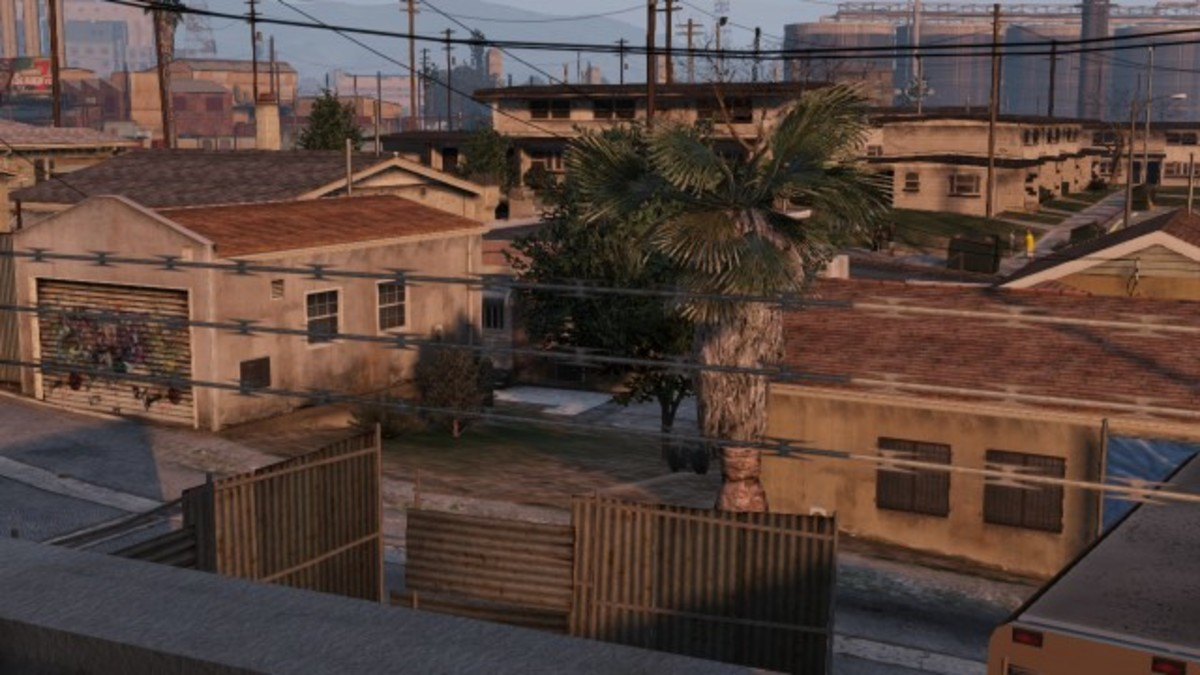Run to this house (behind the tree) after you blow up the first gang vehicle.