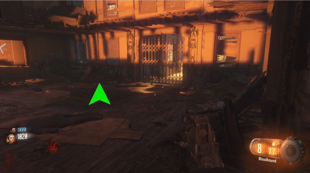 This first possible location is on the floor in the room connected to the perk room. It is hard to find since it is against clutter on the ground.