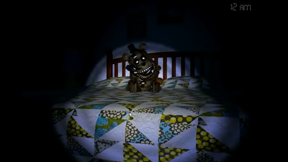 A Freddy plushie glares at the player. It's so adorably evil.
