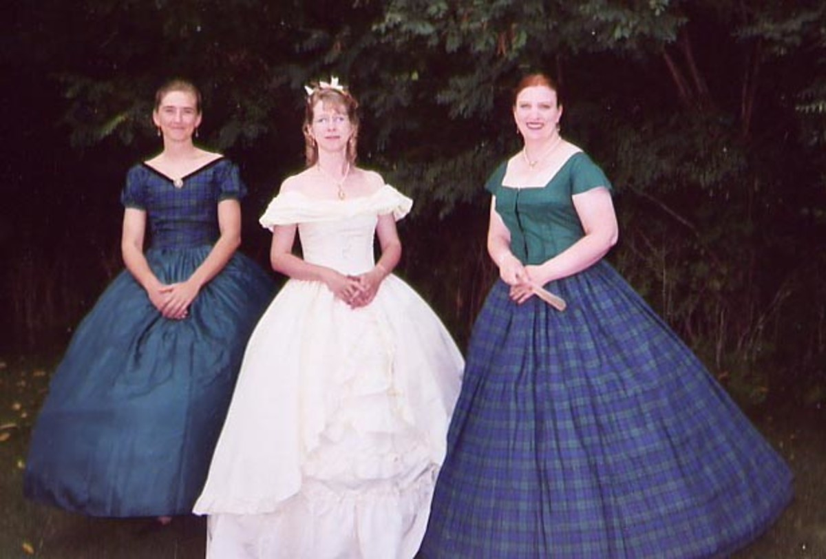 Me (center) and my two friends Carla and Sara (3rd MI) going to the ball in Jackson, MI in 2003. The dress I'm wearing is an old Gunne Sax prom dress!