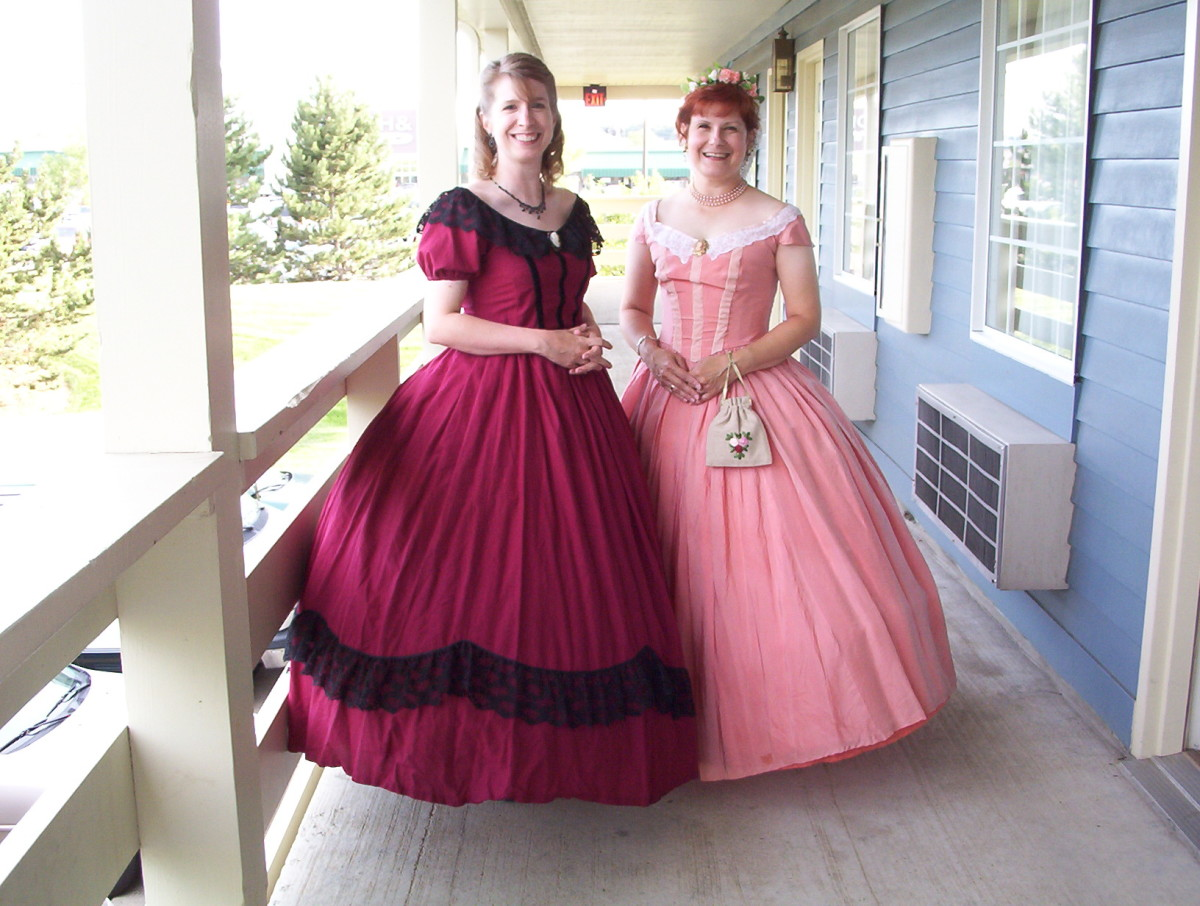 My sister made the dress on the left; the dress on the right is the same one shown above, now worn by my friend Joan, who heard me talking about reenacting and wanted to try it out. I have cool friends!