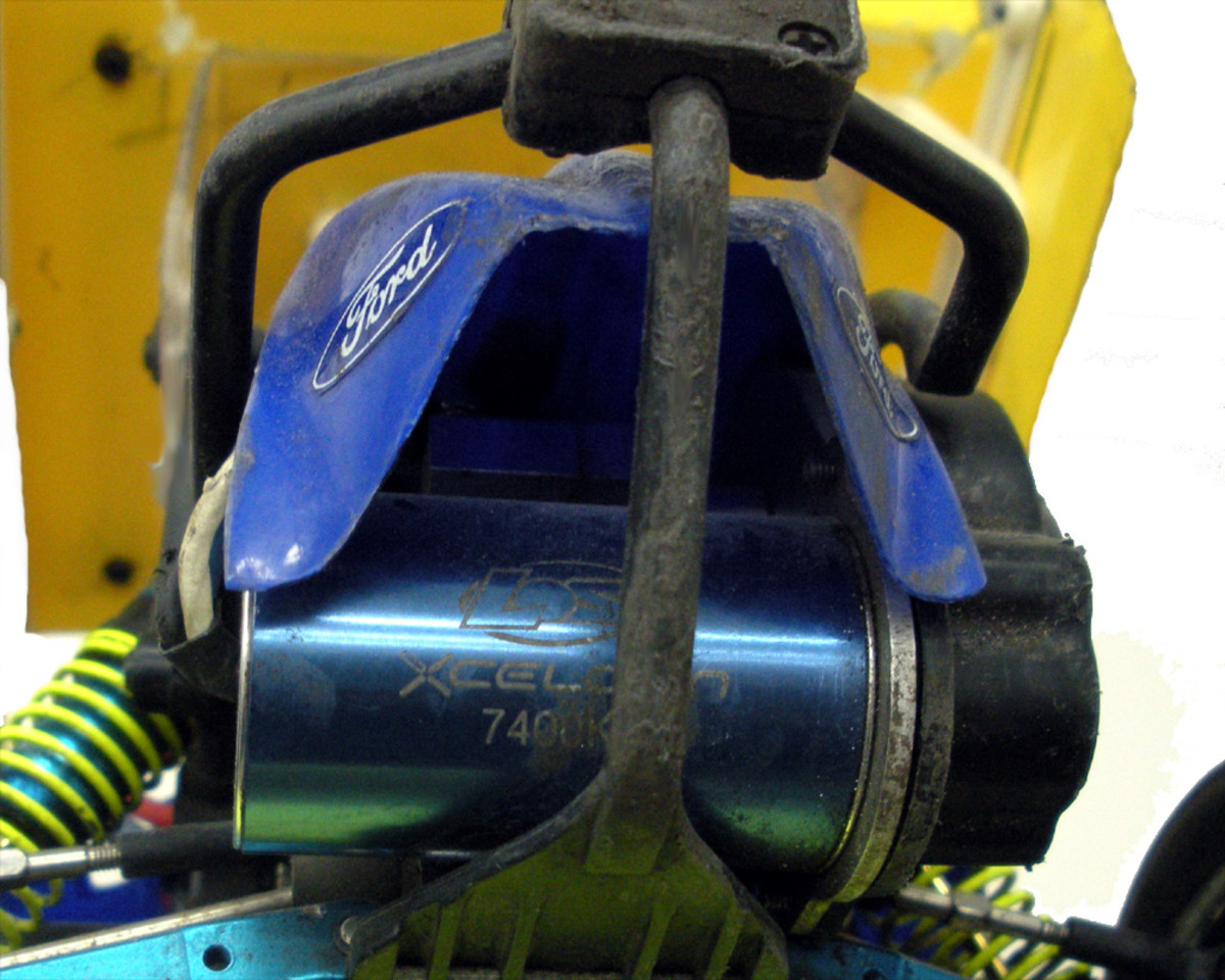 A brushless motor installed in a vehicle.  This car is set up for running dirt ovals; note the skid plate and roll cage protecting motor.