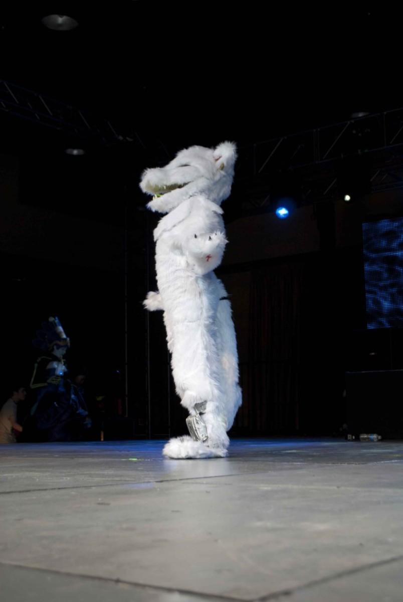 fursuiter on stage at a con.
