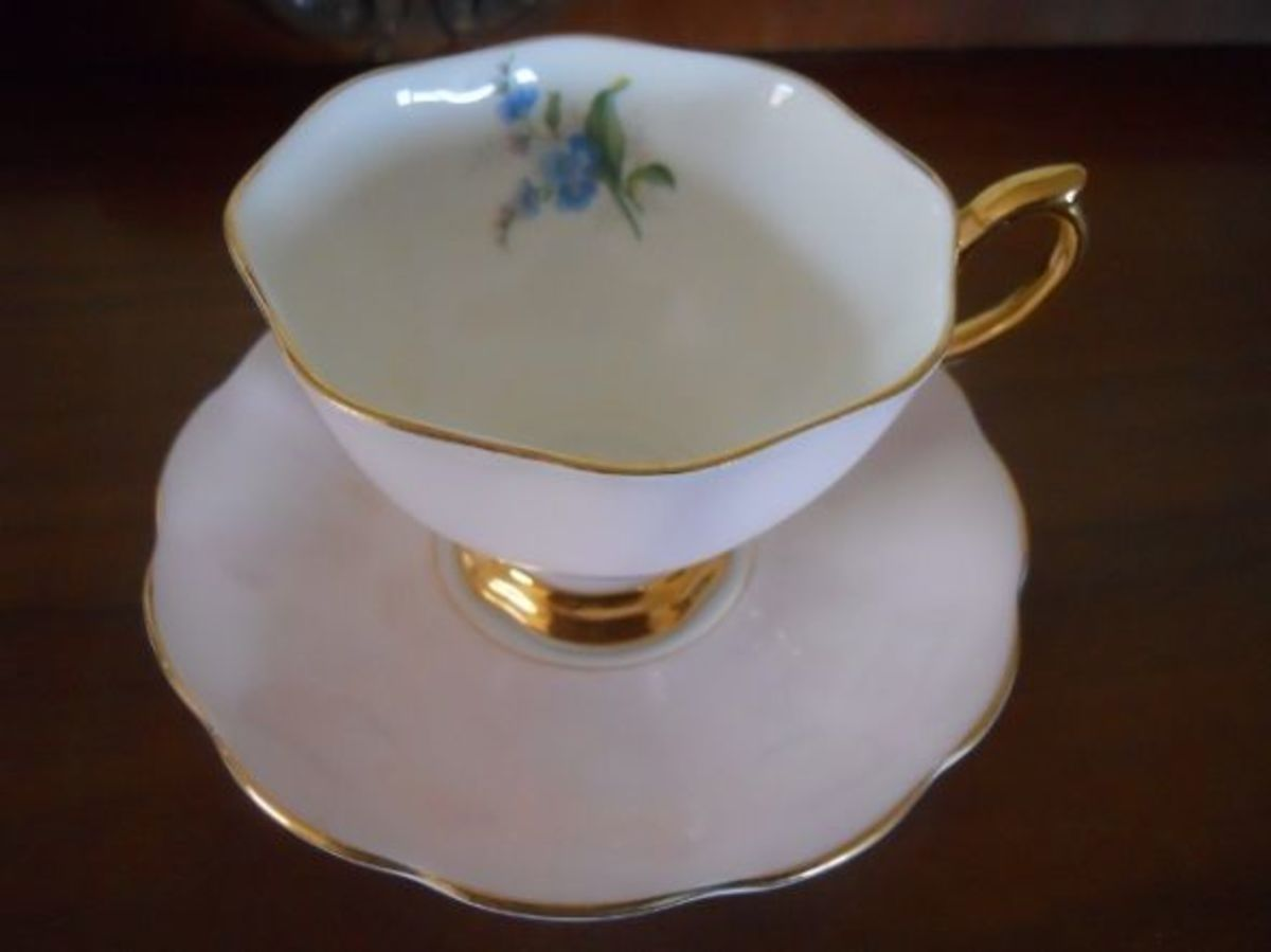 This Royal Albert cup has it's design inside the cup; plain pink outside.