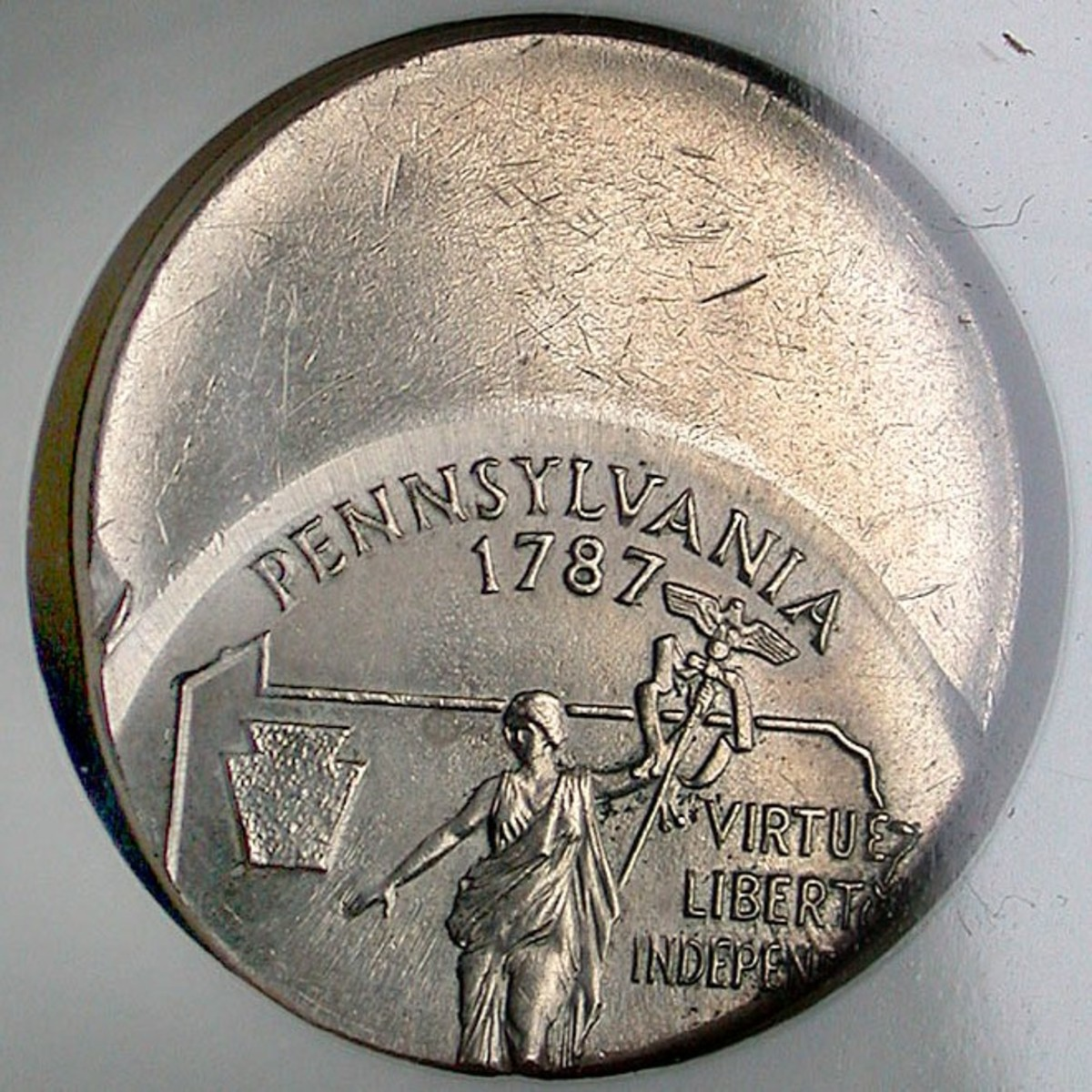 1999 Pennsylvania Off Center Strike. Photo Courtesy: coinpage.com