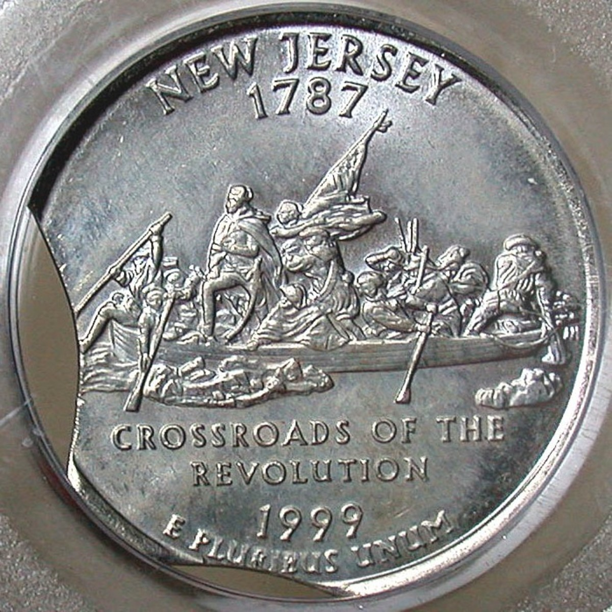 1999 New Jersey Clipped Die Error. Photo Courtesy: coinpage.com