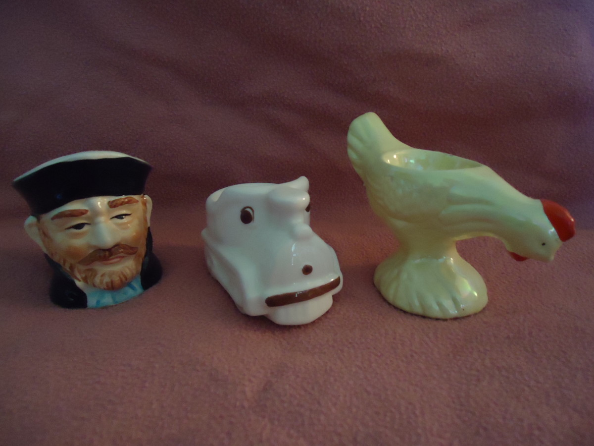 Examples of figural egg cups.