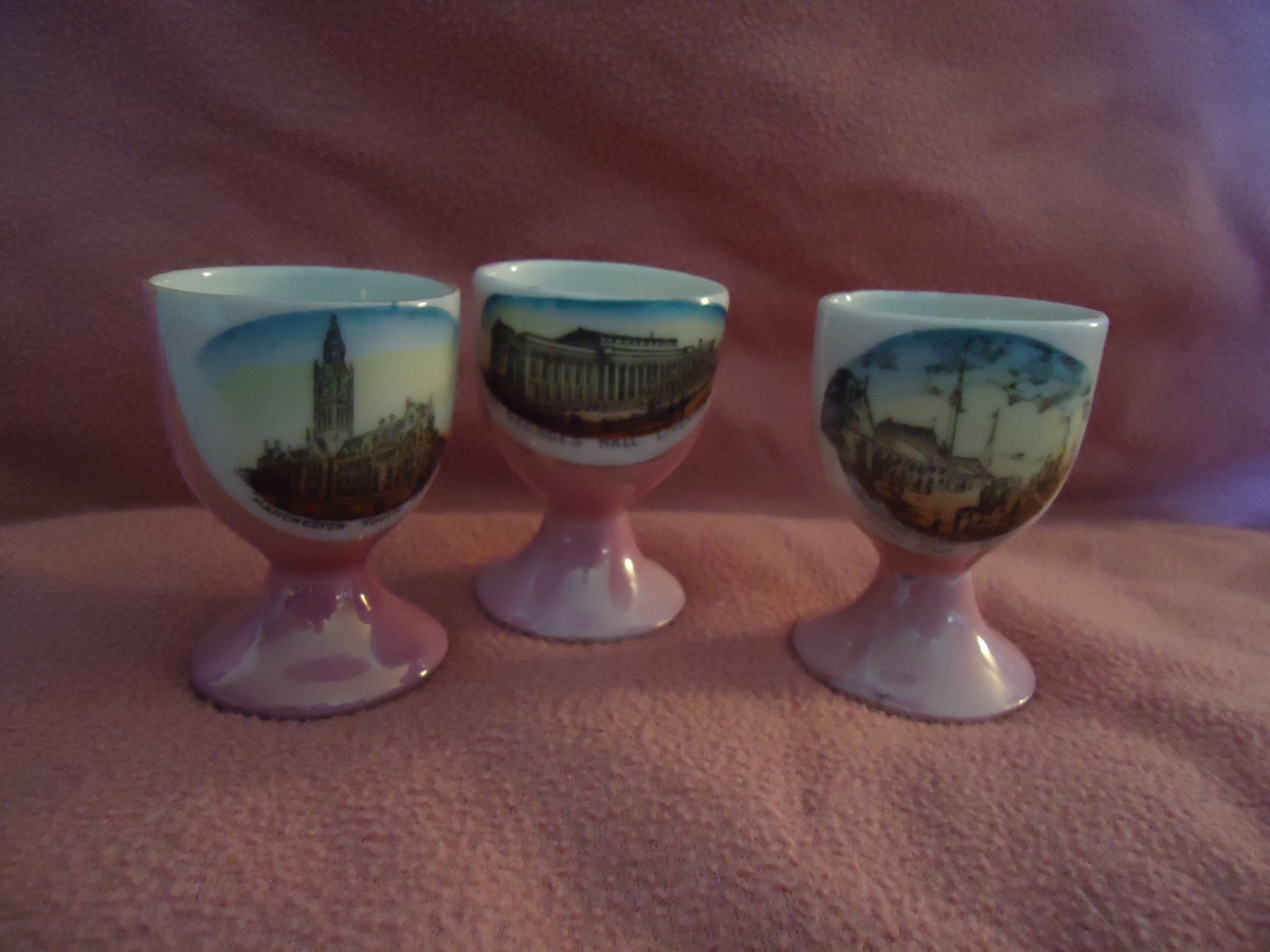 Pink souvenir cups; an egg cup series of places and monuments in Europe.